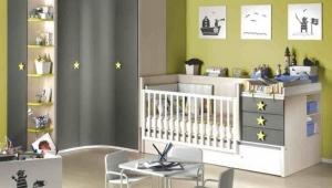 HABITACIÓN INFANTIL CON CUNA CONVERTIBLE EN ACABADO MAPLE, COMBINADO CON UN ACABADO PIZARRA Y TIRADOR DE ESTRELLA EN PISTACHO.
